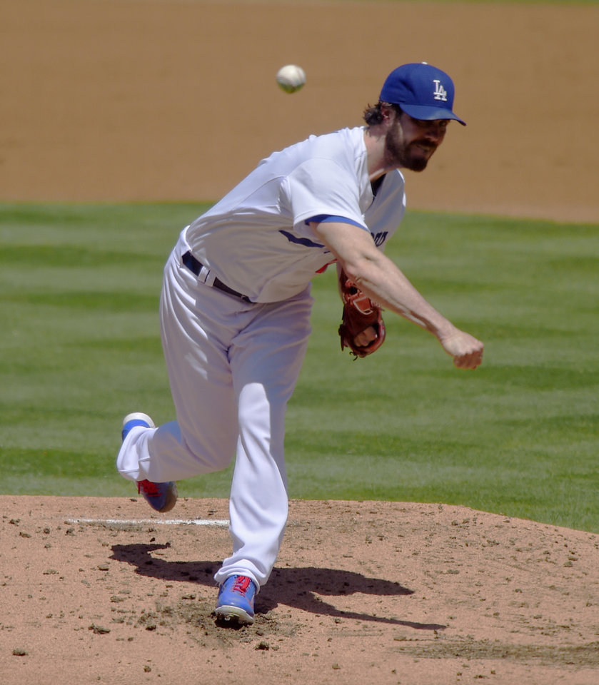 Photo - Los Angeles Dodgers starting pitcher Dan Haren throws to the plate during the first inning of a baseball game against the Milwaukee Brewers, Sunday, Aug. 17, 2014, in Los Angeles. (AP Photo/Mark J. Terrill)
