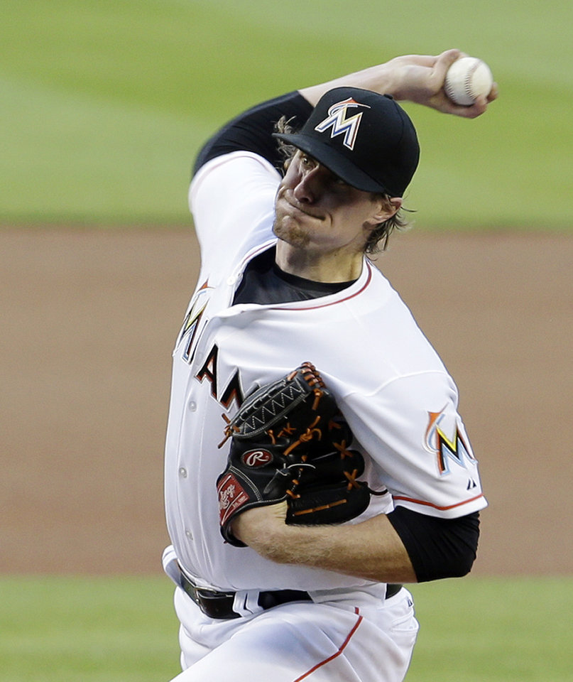 Photo - Miami Marlins' Tom Koehler pitches against the Milwaukee Brewers in the first inning of a baseball game in Miami, Friday, May 23, 2014. (AP Photo/Alan Diaz)