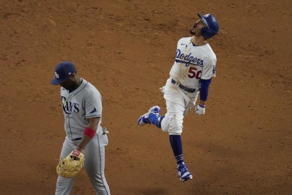 Photo -  Los Angeles Dodgers' Mookie Betts celebrates after a home run against the Tampa Bay Rays during the eighth inning in Game 6 of the baseball World Series Tuesday, Oct. 27, 2020, in Arlington, Texas. (AP Photo/Sue Ogrocki)