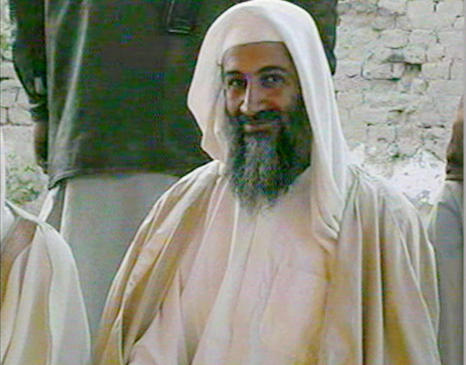 Photo - FILE - In this file television image broadcast on Qatar's Al-Jazeera TV, is said to show Osama bin Laden, at the wedding of his son in January of 2001. A person familiar with developments said Sunday, May 1, 2011 that bin Laden is dead and the U.S. has the body. (AP Photo/Al-Jazeera/TV, file) ORG XMIT: NY207