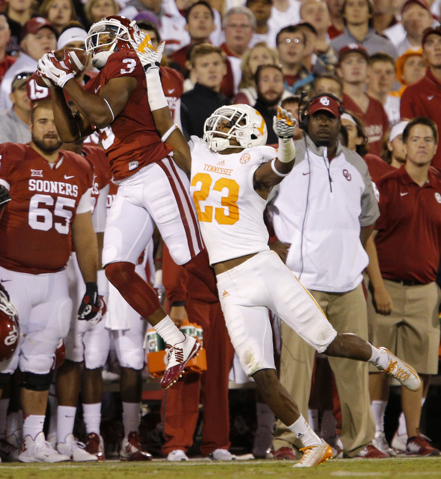 Photo - Oklahoma's Sterling Shepard (3) catches the ball over Tennessee's Cameron Sutton (23) during a college football game between the University of Oklahoma Sooners (OU) and the Tennessee Volunteers at Gaylord Family-Oklahoma Memorial Stadium in Norman, Okla., on Saturday, Sept. 13, 2014. Photo by Bryan Terry, The Oklahoman