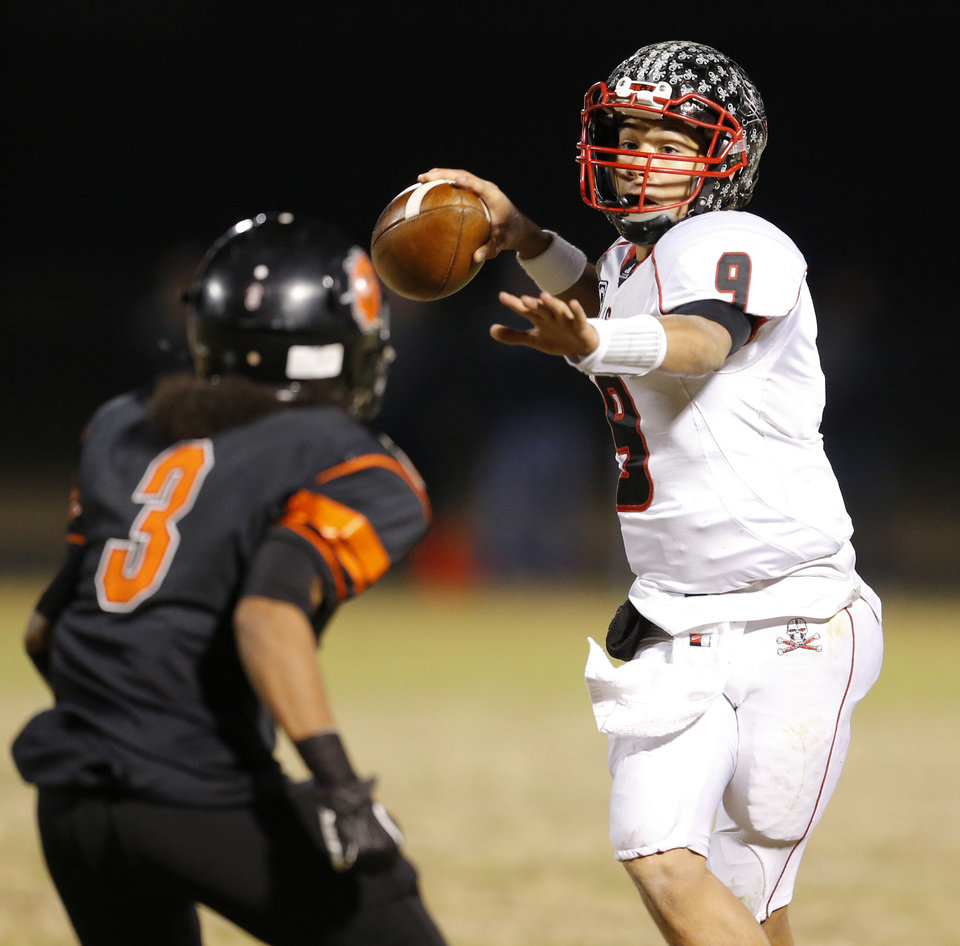 Photo - Locust Grove's Mason Fine looks to throw against Douglass during their high school football playoff game at Douglass in Oklahoma City, Friday, Nov. 28, 2014. Photo by Bryan Terry, The Oklahoman