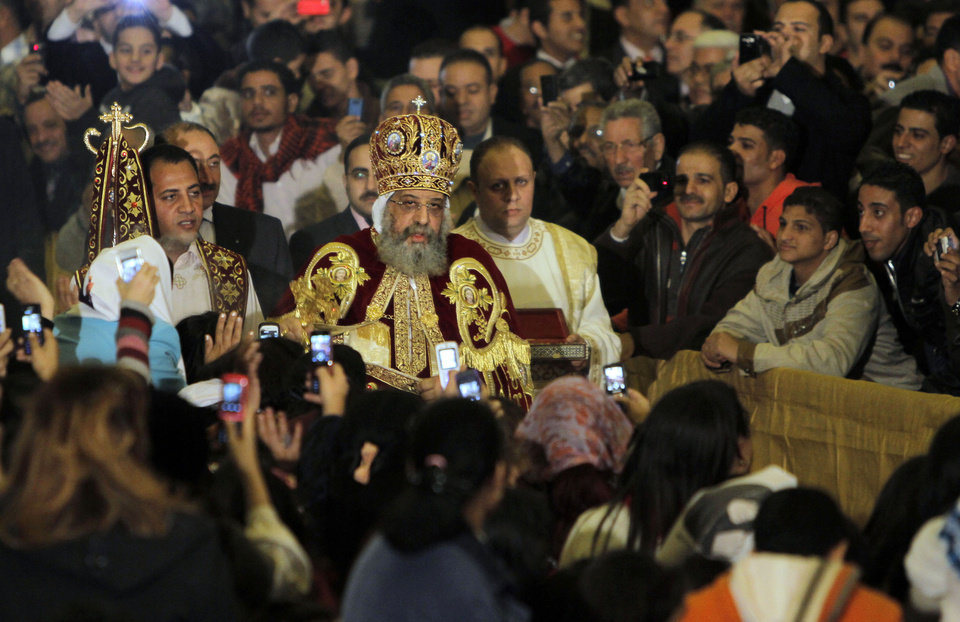 Pope Tawadros II, the 118th pope of the Coptic Church of Egypt, leads a midnight Mass on the eve of Orthodox Christmas at St. Mark's Cathedral in Cairo, Egypt, late Sunday Jan. 6, 2013. (AP Photo/Amr Nabil)