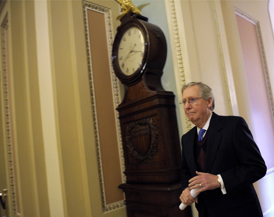 Photo - Senate Minority Leader Mitch McConnell of Ky. walks to the Senate floor on Capitol Hill in Washington, Thursday, Dec. 27, 2012. (AP Photo/Susan Walsh)