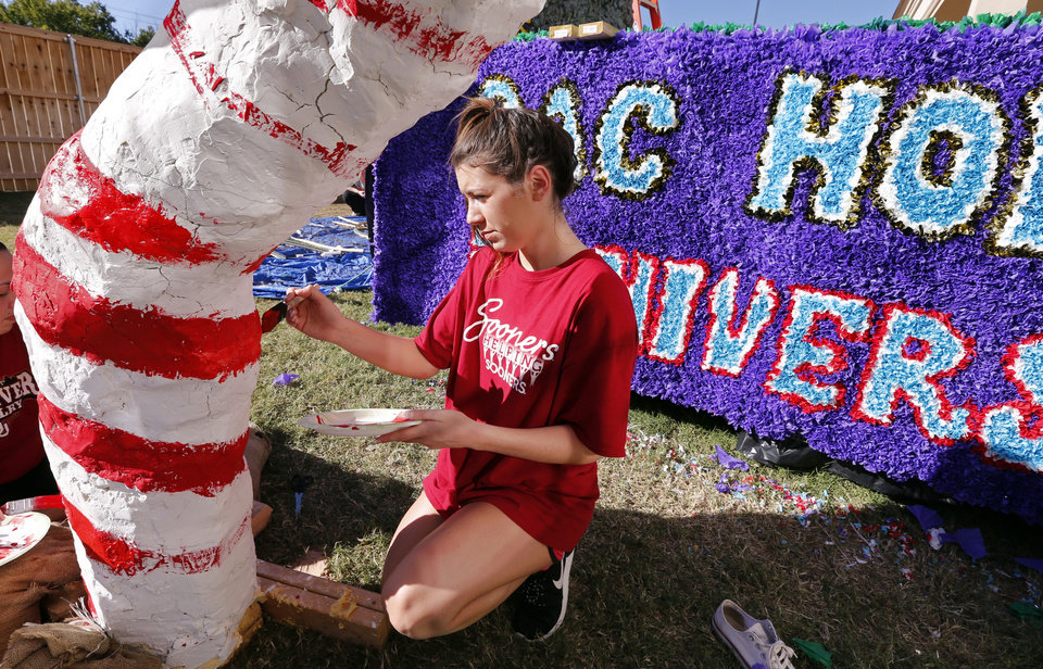 Photo - University of Oklahoma student and Gamma Phi Beta member Sloan Carr works on a homecoming float.  PHOTOS BY STEVE SISNEY, THE OKLAHOMAN  STEVE SISNEY -