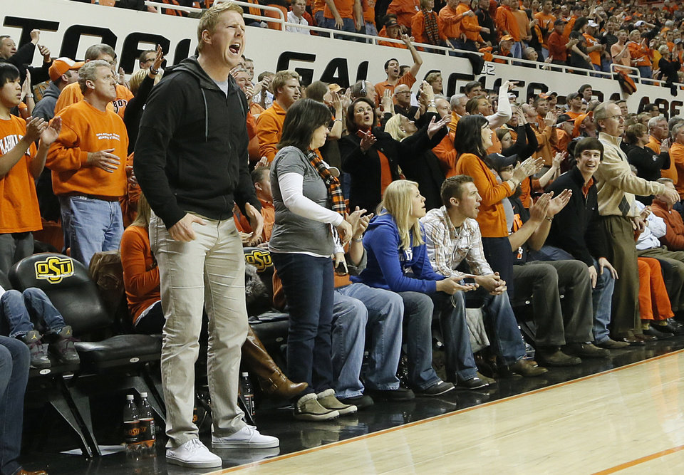 Former Oklahoma State quarterback Brandon Weeden yells at the officials during the college basketball game between the Oklahoma State University Cowboys (OSU) and the University of Kanas Jayhawks (KU) at Gallagher-Iba Arena on Wednesday, Feb. 20, 2013, in Stillwater, Okla. Photo by Chris Landsberger, The Oklahoman