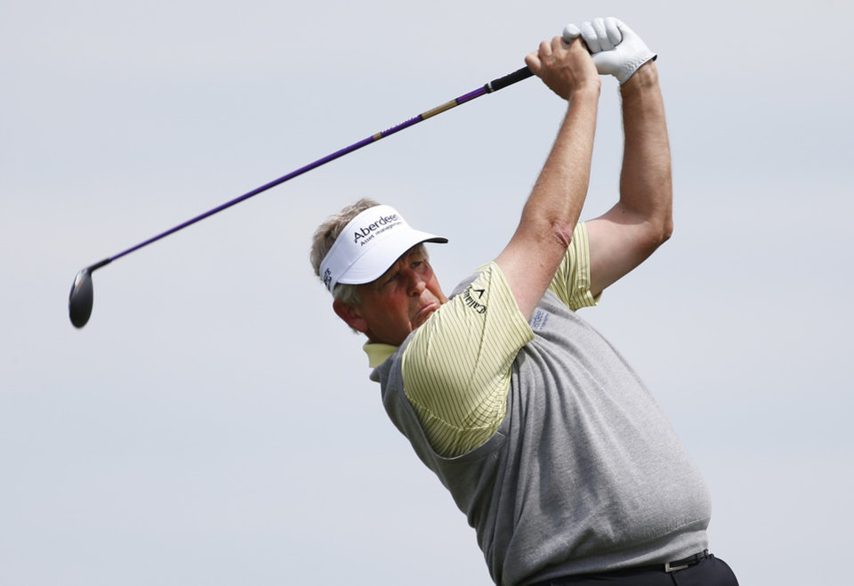 Photo - Colin Montgomerie watches his tee shot on the first hole during the first round of the Senior PGA Championship golf tournament at Harbor Shores Golf Club in Benton Harbor, Mich., Thursday, May 22, 2014.  (AP Photo/Paul Sancya)