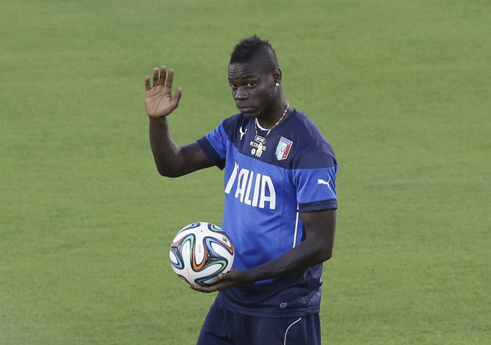 Photo - Italy's Mario Balotelli waves prior to a training session of Italy in Natal, Brazil, Saturday, June 21, 2014. Italy plays in group D of the 2014 soccer World Cup. Italy proved ineffective in a 1-0 loss to Costa Rica on Friday and now the Azzurri need a win or a draw against Uruguay on Tuesday to reach the second round. (AP Photo/Antonio Calanni)