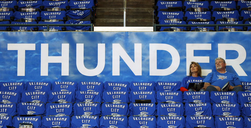 Photo - Fans sits among the sea of Thunder t-shirts before Game 3 of the Western Conference Finals in the NBA playoffs between the Oklahoma City Thunder and the San Antonio Spurs at Chesapeake Energy Arena in Oklahoma City, Sunday, May 25, 2014. Photo by Nate Billings, The Oklahoman