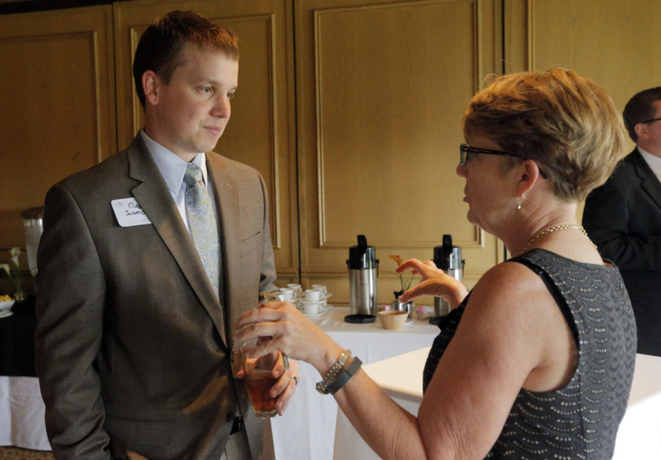 Photo - Gabe Schmidt talks with Debbie Bendick during a new teachers reception at Oak Tree Golf and Country Club. The reception was sponsored by the Edmond Area Chamber of Commerce. PHOTO BY SARAH PHIPPS, THE OKLAHOMAN.  SARAH PHIPPS - SARAH PHIPPS