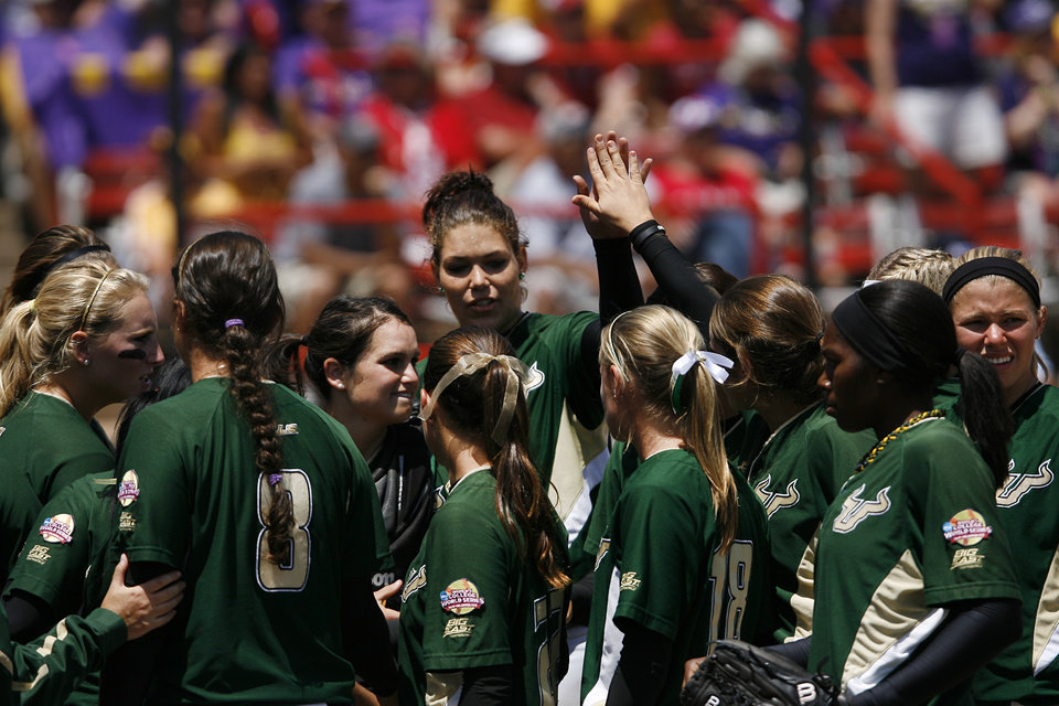 The USF Bulls celebrate during a Women's College World Series game between Louisiana State University and the University of South Florida at ASA Hall of Fame Stadium in Oklahoma City, Saturday, June 2, 2012.  Photo by Garett Fisbeck, The Oklahoman