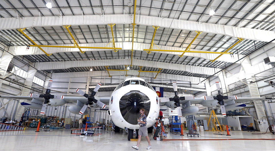 Photo - FILE-This July 15, 2014 file photo shows a custom-fitted research C-130 sits in a hanger being prepared for research flights, at Rocky Mountain Metropolitan Airport, in Broomfield, Colo. An intensive campaign to measure air pollution along Colorado's northern Front Range will produce a wealth of data to help identify the sources and levels of harmful ozone, researchers said Tuesday, Aug. 26, 2014. (AP Photo/Brennan Linsley,File)