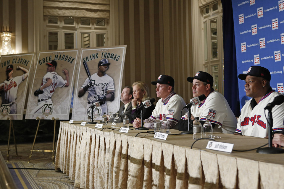 Photo - Former Atlanta Braves pitchers Tom Glavine, third from left, and Greg Maddux, second from right, sit beside former Chicago White Sox slugger Frank Thomas, right, during a press conference announcing their election to the 2014 Baseball Hall of Fame class, Thursday, Jan. 9, 2014, in New York. From left are Baseball Writers Association of America Secretary/Treasurer Jack O' Connell, and Baseball Hall of Fame chairman Jane Forbes Clark. (AP Photo/Kathy Willens)