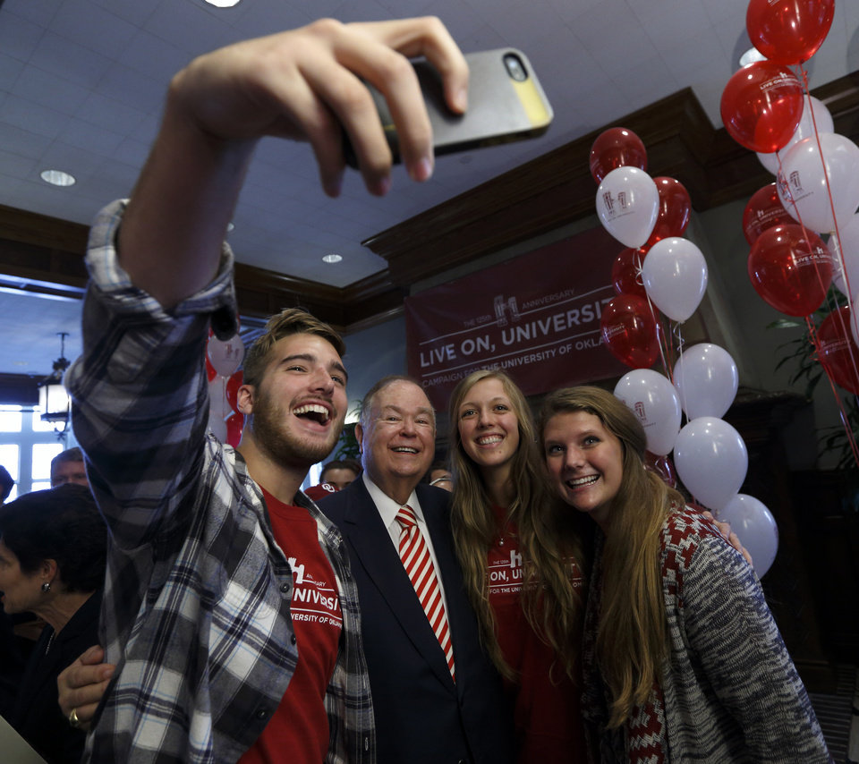 Photo - University of Oklahoma (OU) President David Boren poses with students Peyton Vann, Edmond freshman, Anna Brewster, junior, and Courtney Cassady, freshman (both from Frisco, Texas), after he holds a press conference and rally on Friday, Sept. 12, 2014 in Norman, Okla.  Photo by Steve Sisney, The Oklahoman