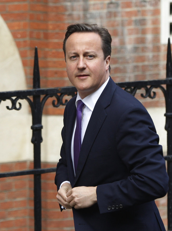 Photo -   British Prime Minister David Cameron arrives to give evidence at the Leveson inquiry at the Royal Courts of Justice in central London, Thursday, June 14, 2012. The judge-led inquiry was set up following revelations of phone hacking at Murdoch's News of the World tabloid. The scandal has shaken the British establishment and raised questions about whether top politicians helped shield Murdoch from scrutiny. (AP Photo/Lefteris Pitarakis)