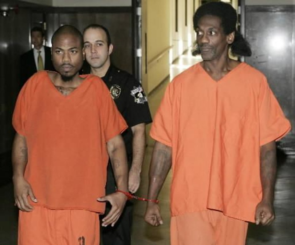 Emanuel Mitchell and Anthony Morrison are taken into Judge Fred Doak's courtroom in the Oklahoma County Courthouse in Oklahoma City, Oklahoma September 25, 2009. Photo by Steve Gooch, The Oklahoman