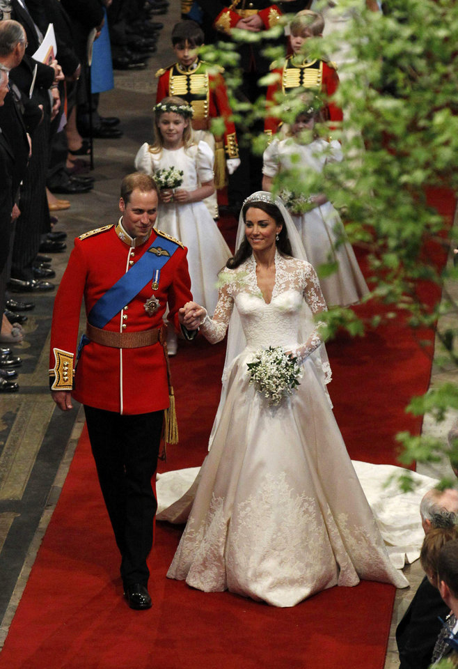 Photo - Britain's Prince William, left, and is bride Kate, Duchess of Cambridge, walk down the aisle after their wedding ceremony in Westminster Abbey, in central London Friday April 29, 2011. (AP Photo/Suzanne Plunkett, Pool) ORG XMIT: RWAJP124
