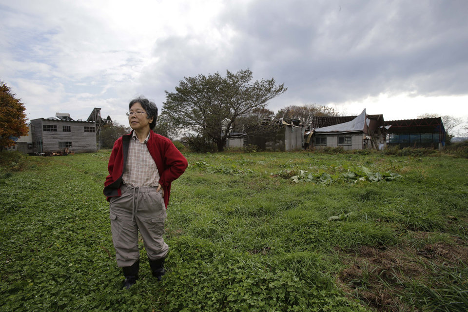 "In this Nov. 7, 2012 photo, farmer Keiko Kikukawa stands in her field in Rokasho village, Aomori Prefecture, northern Japan. By hosting a high-tech facility that would convert spent fuel into a plutonium-uranium mix designed for the next generation of reactors, Rokkasho was supposed to provide fuel while minimizing nuclear waste storage problems. Those ambitions are falling apart because years of attempts to build a ""fast breeder"" reactor, which would use the reprocessed fuel, appear to be ending in failure. ""It's so unfair that Rokkasho is stuck with the nuclear garbage from all over Japan,"" Kikukawa said. ""And it's not going to go away even if the Rokkasho plant stops immediately. We're dumping it all onto our offsprings to take care of. It's so irresponsible."" (AP Photo/Koji Sasahara)"