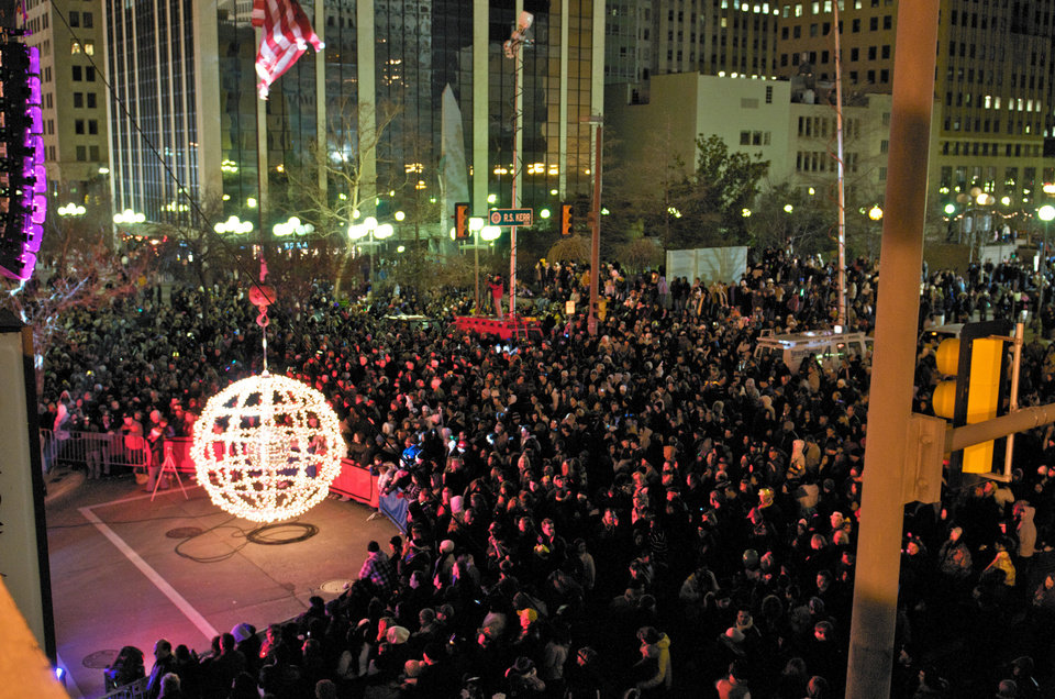 Photo - A crowd waits for the giant lighted ball to ascend to mark the start of a new year at a past Opening Night New Year's Eve celebration in downtown Oklahoma City. An estimated 70,000 people attended the grand finale of last year's Opening Night. Photo provided.