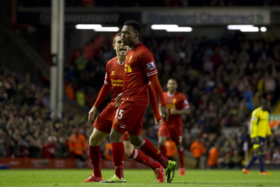 Photo - Liverpool's Daniel Sturridge, centre, celebrates with teammate Jordan Henderson after scoring against Sunderland during their English Premier League soccer match at Anfield Stadium, Liverpool, England, Wednesday, March 26, 2014. (AP Photo/Jon Super)