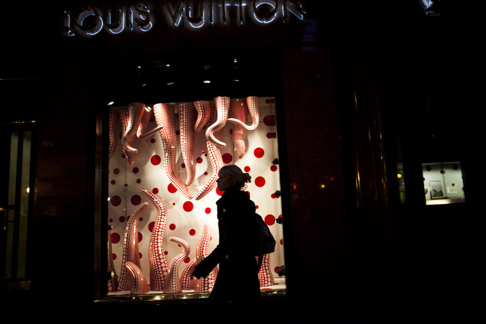 Photo -   In this Sept. 26, 2012 photo, a woman walks by Louis Vuitton store at the Alvear Avenue, in Recoleta neighborhood in Buenos Aires, Argentina. The world's most luxurious designer brands are abandoning Argentina rather than complying with tight new government economic restrictions, leaving empty shelves and storefronts along the capital's elegant Alvear Avenue, where tourists once flocked to see the latest in fashion. (AP Photo/Natacha Pisarenko)