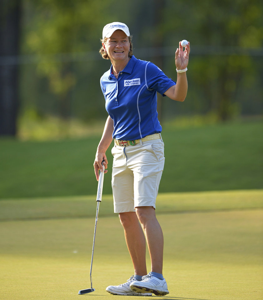 Photo - Catriona Matthew, of Scotland, acknowledges the crowds at the 18th hole after putting in the second round of the Airbus LPGA Classic golf tournament at Magnolia Grove on Friday, May 23, 2014, in Mobile, Ala. (AP Photo/G.M. Andrews)