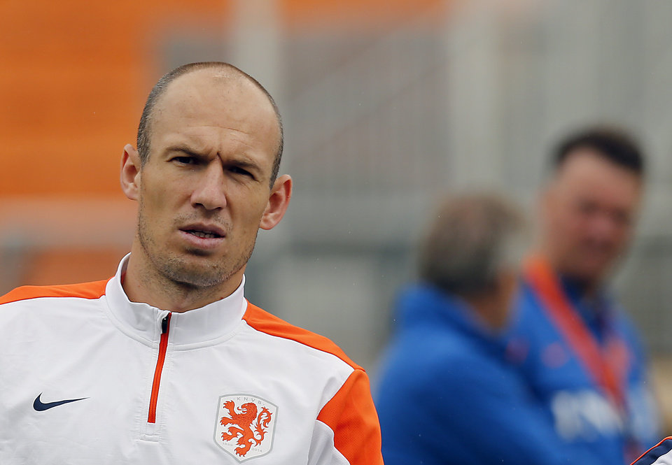 Photo - Netherlands' Arjen Robben warms up during a training session of The Netherlands in Sao Paulo, Brazil, Thursday, July 10, 2014. The Netherlands will face Brazil for the match for third place at the 2014 soccer World Cup. (AP Photo/Frank Augstein)
