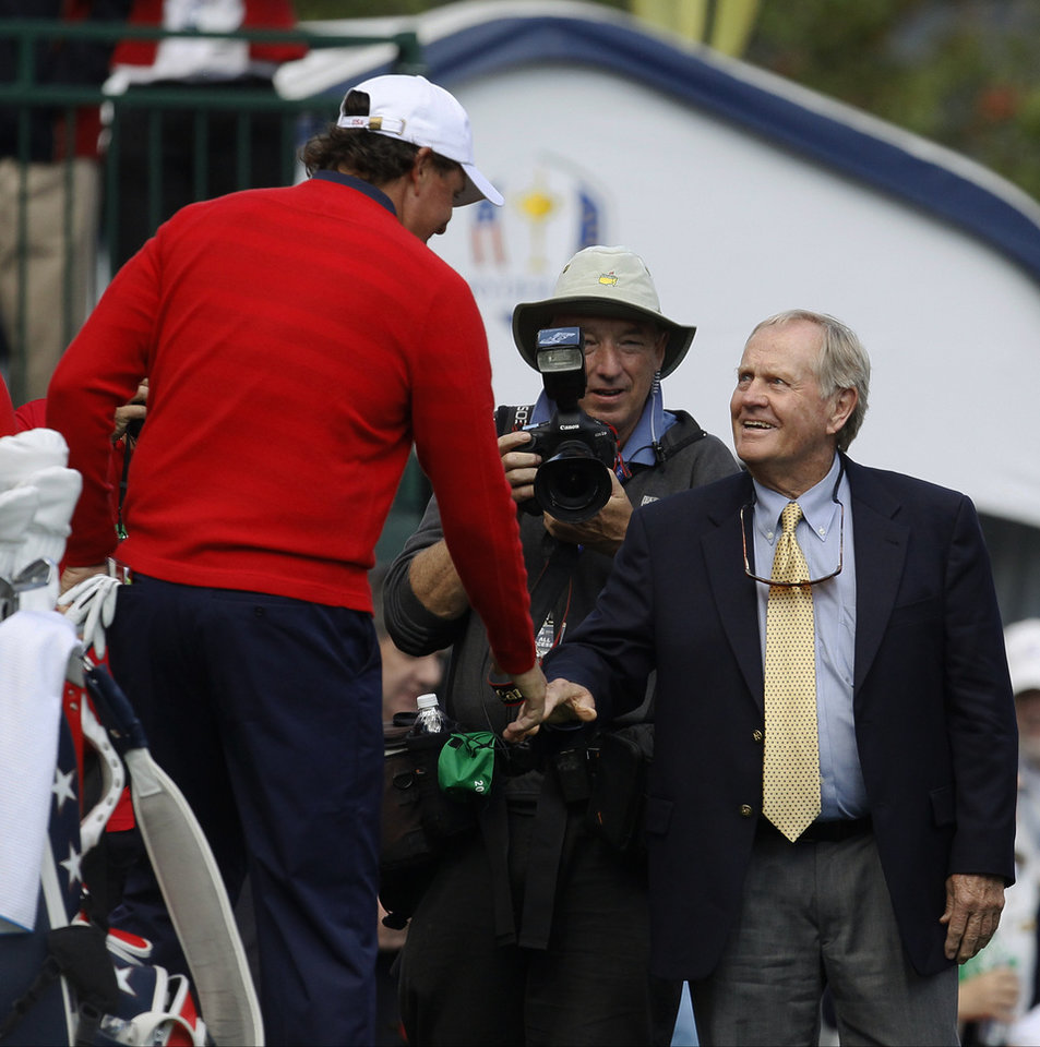 USA's Phil Mickelson, left, shakes hands with Jack Nicklaus on the first hole before a singles match at the Ryder Cup PGA golf tournament Sunday, Sept. 30, 2012, at the Medinah Country Club in Medinah, Ill. (AP Photo/Charles Rex Arbogast)  ORG XMIT: PGA112