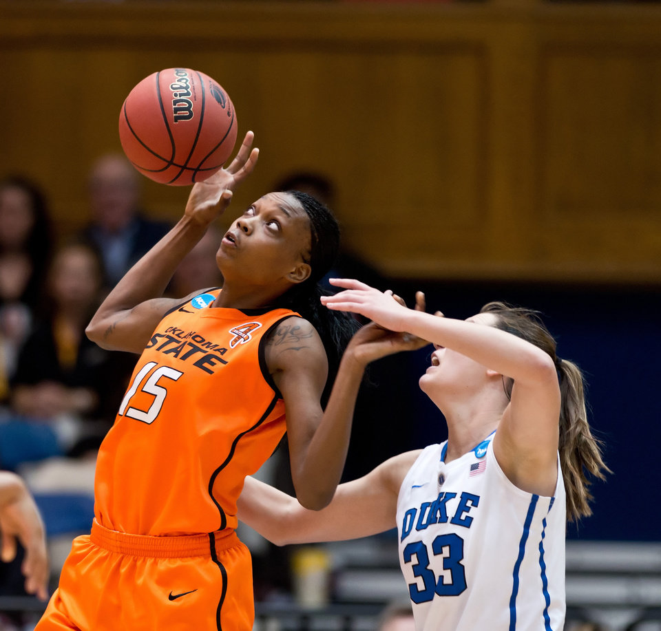 Oklahoma State's Toni Young (15) and Duke's Haley Peters (33) fight for a loose ball during the first half in the women's NCAA Tournament at Cameron Indoor Stadium in Durham, North Carolina, Tuesday, March 26, 2013. (Greg Mintel/Raleigh News & Observer/MCT)