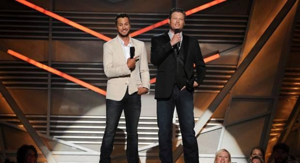 Photo -  Hosts Luke Bryan, left, and Tishomingo resident Blake Shelton speak on stage at the 49th annual Academy of Country Music Awards at the MGM Grand Garden Arena on Sunday, April 6, 2014, in Las Vegas. (AP)