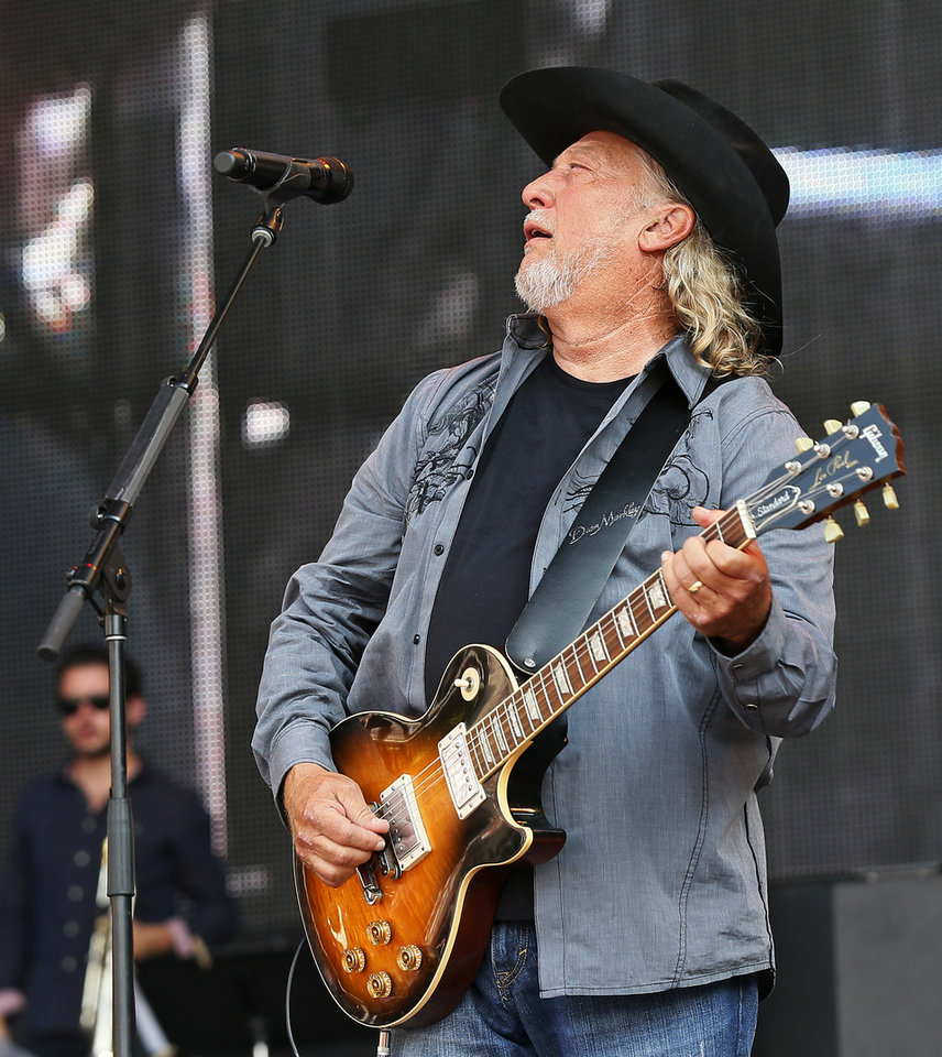 Photo - John Anderson performs during the Oklahoma Twister Relief Concert, benefiting victims of the May tornadoes, at Gaylord Family - Oklahoma Memorial Stadium on the campus of the University of Oklahoma in Norman, Okla., Saturday, July 6, 2013. Photo by Nate Billings, The Oklahoman