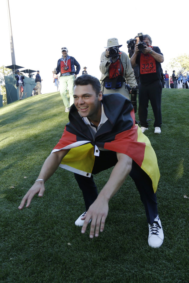 Europe's Martin Kaymer celebrates after winning the Ryder Cup PGA golf tournament Sunday, Sept. 30, 2012, at the Medinah Country Club in Medinah, Ill. (AP Photo/David J. Phillip)  ORG XMIT: PGA212