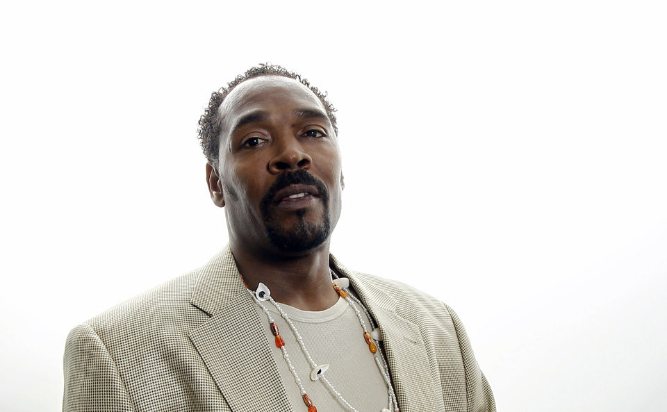 On April 13, 2012, Rodney King poses for a portrait in Los Angeles. The acquittal of four police officers in the videotaped beating of King sparked rioting that spread across the city and into neighboring suburbs. Cars were demolished and homes and businesses were burned. Before order was restored, 55 people were dead, 2,300 injured and more than 1,500 buildings were damaged or destroyed.(AP Photo/Matt Sayles)