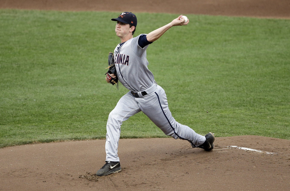 Photo - Virginia's Brandon Waddell pitches in the first inning of Game 2 of the best-of-three NCAA baseball College World Series finals against Vanderbilt in Omaha, Neb., Tuesday, June 24, 2014. (AP Photo/Nati Harnik)