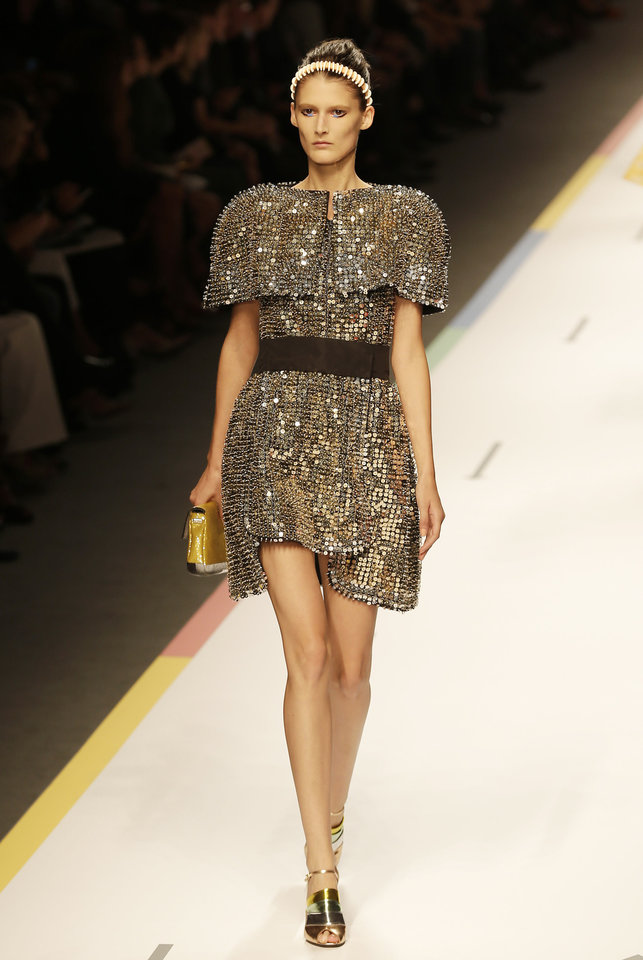 Photo -   A model wears a creation part of the Fendi women's Spring-Summer 2013 fashion collection, during the fashion week in Milan, Italy, Saturday, Sept. 22, 2012. (AP Photo/Antonio Calanni)