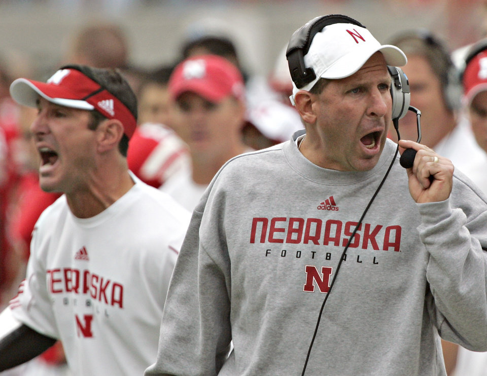 Photo - University of Nebraska head coach Bo Pelini, right, and linebackers coach Mike Ekeler, left, yell instructions in the first half of a NCAA college football game against San Jose State, in Lincoln, Neb., Saturday, Sept. 6, 2008. Nebraska won 35-12. (AP Photo/Nati Harnik) ORG XMIT: NENH106