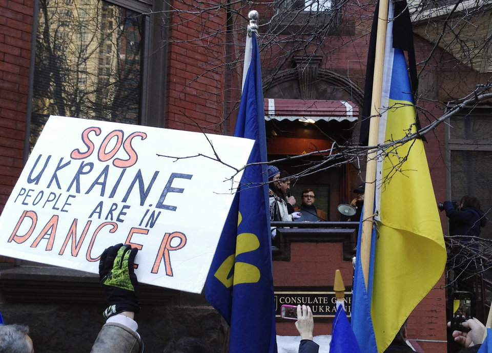 Photo - CORRECTS TO UKRAINIAN CONSULATE INSTEAD OF EMBASSY - Ukrainians gather outside the Ukrainian Consulate in Chicago, Wednesday, Feb. 19, 2014, to protest the deadly violence in the capital of Kiev and call for a stronger response by the United States and the European Union. Clashes on Tuesday left 25 people dead in the worst violence in nearly three months of anti-government protests in Ukraine's capital. Protests began after the president backed away from a deal to join the European Union. (AP Photo/Tammy Webber)