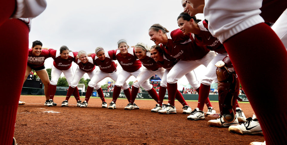Sooner players form a victory huddle in the infield following the NCAA Super Regional softball game as the University of Oklahoma (OU) Sooners defeat Texas A&M 8-0 at Marita Hines Field on Saturday, May 25, 2013 in Norman, Okla. to advance to the College World Series.  Photo by Steve Sisney, The Oklahoman