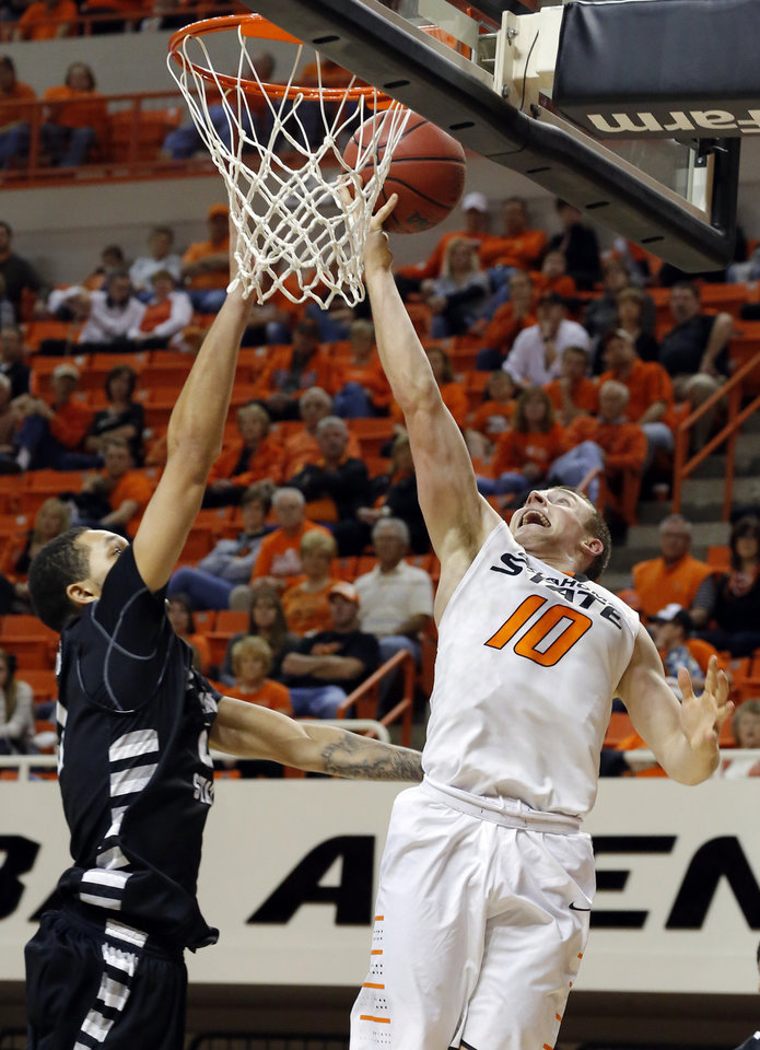 Oklahoma State\'s Phil Forte (10) shoots over Portland State\'s Aaron Moore (21) during the college basketball game between Oklahoma State University and Portland State, Sunday,Nov. 25, 2012. Photo by Sarah Phipps, The Oklahoman