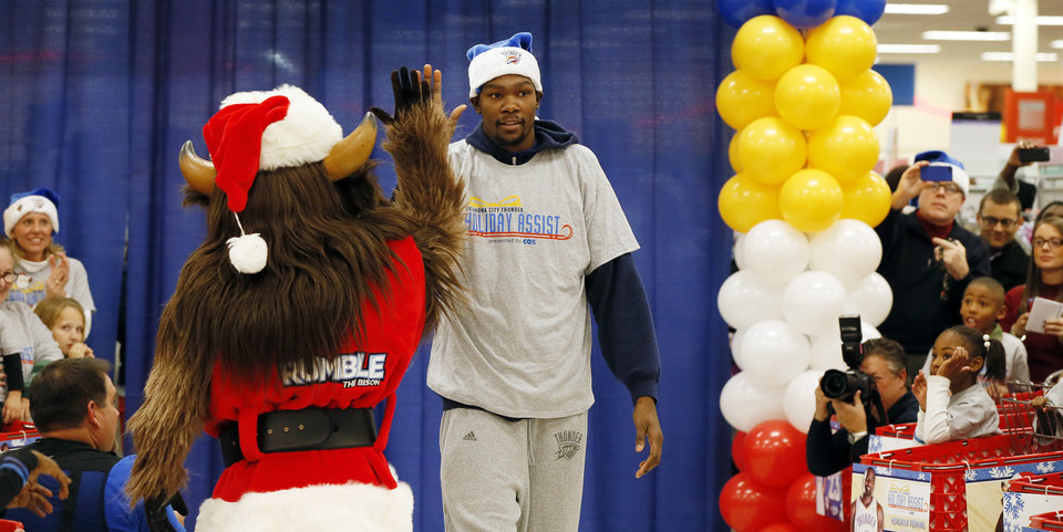 Kevin Durant is introduced during the Oklahoma City Thunder's annual Holiday Assist shopping spree at Target, 13924 N Pennsylvania, in Oklahoma City, Monday, Dec. 10, 2012. The ten families who participated in this year's shopping spree are from Sunbeam Family Services' Grandparents Raising Grandchildren program. Photo by Nate Billings, The Oklahoman