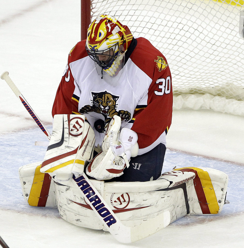 Photo -   Florida Panthers goalie Scott Clemmensen makes a save against the New Jersey Devils during the third period of Game 6 of a first-round NHL hockey Stanley Cup playoff series, Tuesday, April 24, 2012, in Newark, N.J. (AP Photo/Julio Cortez)