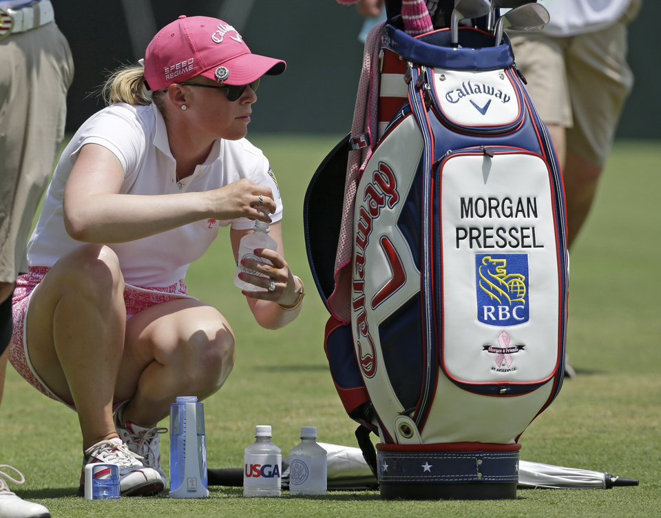 Photo - Morgan Pressel takes a water break on the 13th tee during the first round of the U.S. Women's Open golf tournament in Pinehurst, N.C., Thursday, June 19, 2014. (AP Photo/Bob Leverone)