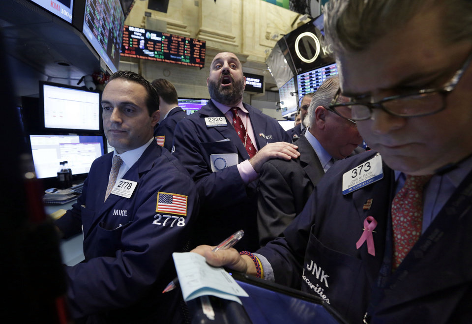 Photo - Specialist Peter Giacchi, center, calls out prices during the IPO of Sprague Resources on the floor of the New York Stock Exchange, Friday, Oct. 25, 2013. Earnings gains from Microsoft and other big U.S. companies are pushing the stock market higher in early trading. (AP Photo/Richard Drew)