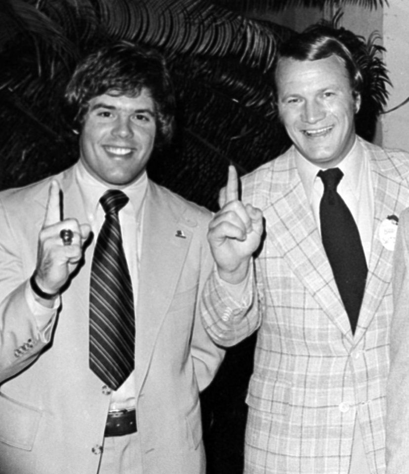 Photo - FILE - In this Jan. 2, 1976 file photo, University of Oklahoma football coach Barry Switzer, right, and quarterback Steven Davis, give the