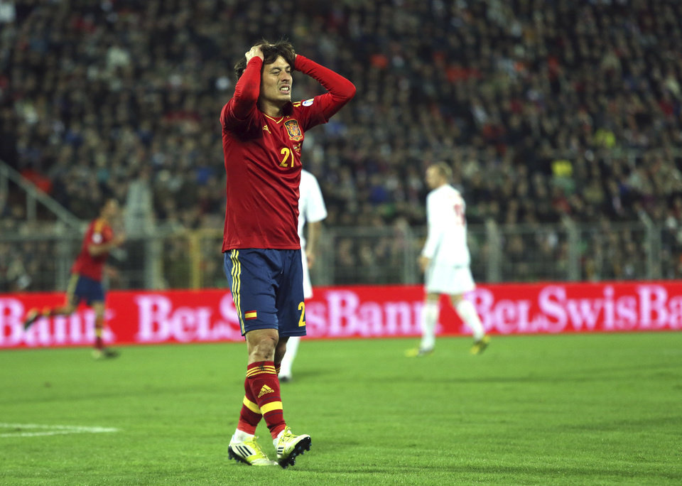 Spain's David Silva reacts after failed a goal during a World Cup 2014 Group qualification match between Belarus and Spain national teams in Minsk, Belarus, on Friday, Oct. 12, 2012.(AP Photo/Sergei Grits)