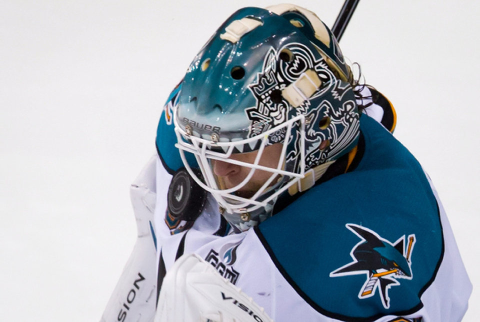 Photo - San Jose Sharks' goalie Antti Niemi, of Finland, makes a save against the Vancouver Canucks during the second period of an NHL hockey game in Vancouver, British Columbia, Tuesday, March 5, 2013. (AP Photo/The Canadian Press, Darryl Dyck)