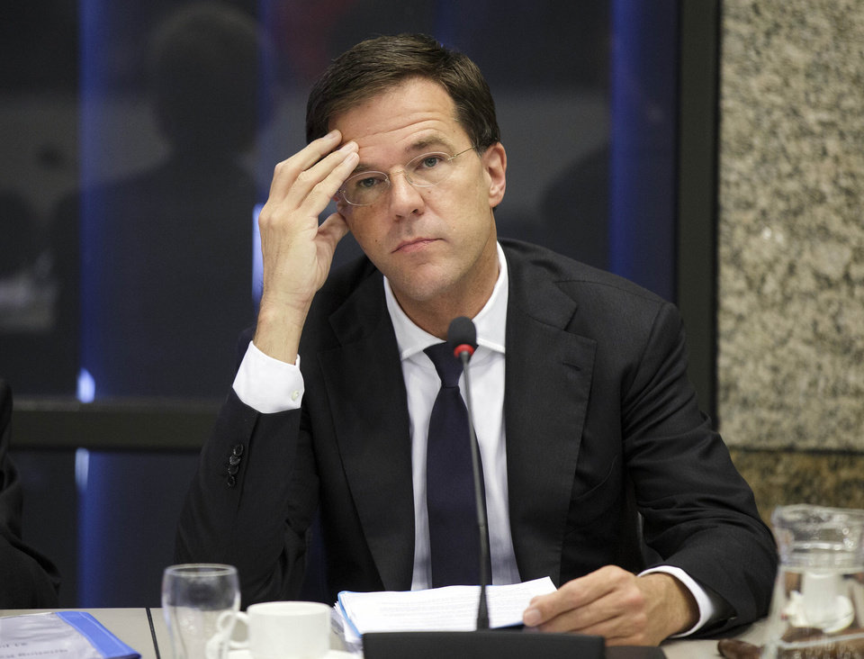 Photo - Dutch Prime Minister Mark Rutte awaits the start of a meeting in The Hague, Netherlands, Monday, July 21, 2014. Rutte briefed lawmakers about his government's response to Thursday's downing of Malaysia Airlines Flight 17 that claimed 193 Dutch lives. Rutte says he has made it 'crystal clear' to Russian President Vladimir Putin that he must use his influence with rebels to ensure unhinderd access to the crash scene for international investigators. (AP Photo/Phil Nijhuis)