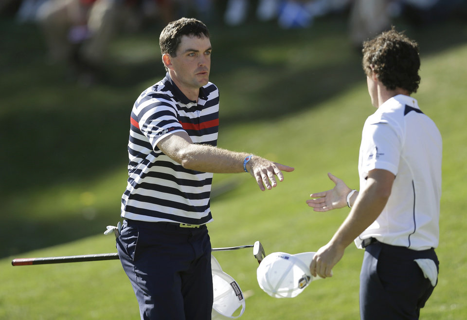 USA's Keegan Bradley congratulates Europe's Rory McIlroy after their singles match at the Ryder Cup PGA golf tournament Sunday, Sept. 30, 2012, at the Medinah Country Club in Medinah, Ill. (AP Photo/David J. Phillip)  ORG XMIT: PGA159