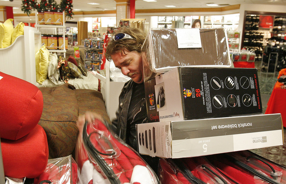 Photo - Black Friday. Robert Harris carries a stack of boxes as he shops at  J.C. Penney's in Penn Square Mall, Friday, November 27, 2009. The doors opened at 4:00 A.M. By David McDaniel, The Oklahoman.