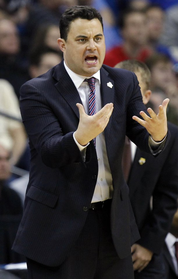 Photo - Arizona coach Sean Miller gives instructions to his team in the second half during the NCAA men's basketball tournament second round game between Arizona and Memphis at the BOK Center in Tulsa, Okla., Friday, March 18, 2011. Arizona won, 77-75. Photo by Nate Billings, The Oklahoman